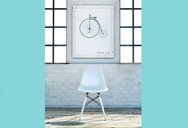 An A2 poster that has been framed with penny farthing design