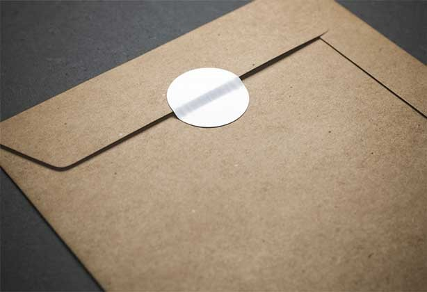 White circular stickers on a brown envelope