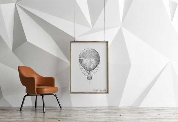 Poster hanging in gallery with a hot air balloon design