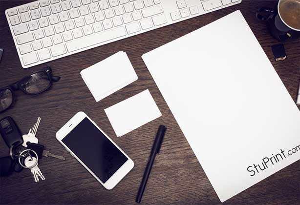 Letterheads and business cards on a desk