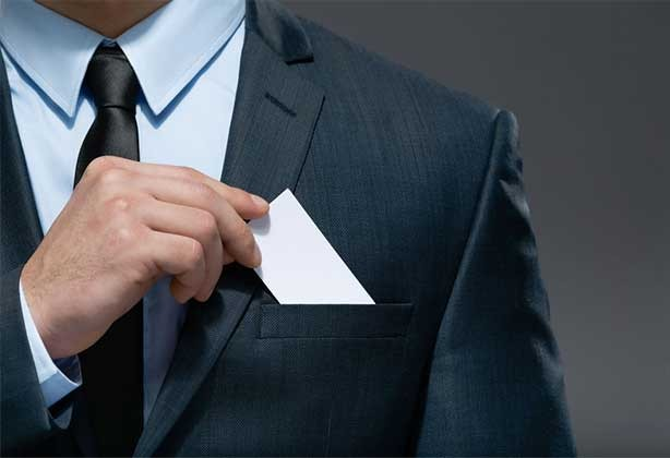 Man putting premium business card in pocket