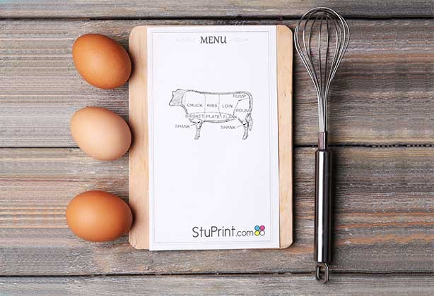 A5 menu design lying next do eggs